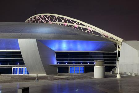 Aspire Dome illuminated at night. Doha, Qatar, Middle East