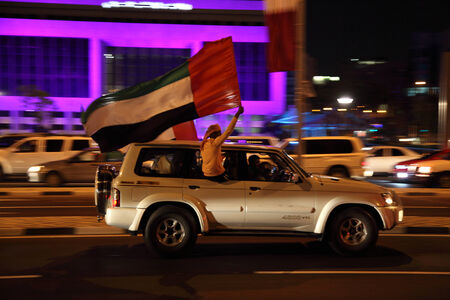 national day: Qatar National Day celebration with a flag of UAE on the corniche road of Doha. Qatar, Middle East Editorial