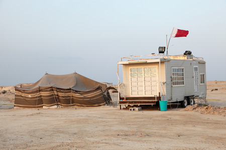 Bedoiun tent and a trailer at the Gulf coast in Qatar photo