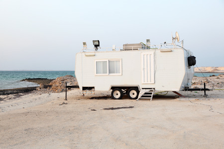 Trailer at the Arabian Gulf beach in Qatar, Middle East photo