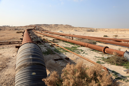Oil and gas pipeline in the desert of Bahrain, Middle East photo