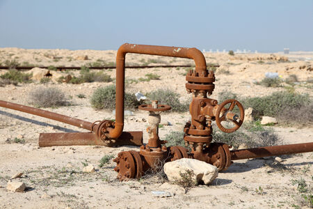Rusty oil pipes in the desert of Bahrain. Middle East photo