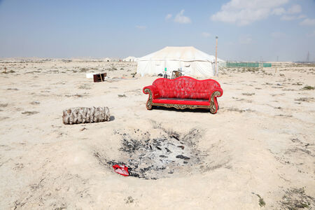 Barbecue place with red sofa in the desert of Bahrain, Middle East photo