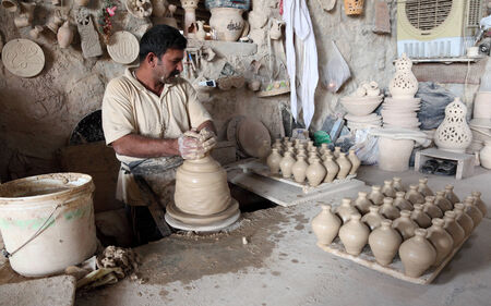 ceramicist: Potter in a pottery workshop. Bahrain, Middle East