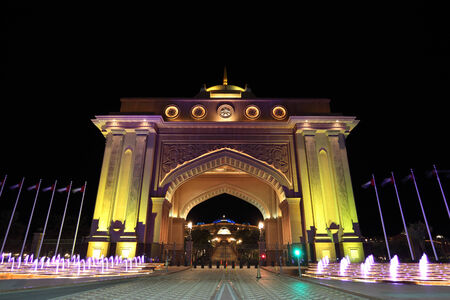 abudhabi: Emirates Palace gate illuminated at night. Abu Dhabi, United Arab Emirates
