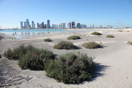 Abu Dhabi skyline as seen from Saadiyat Island beach, United Arab Emirates photo