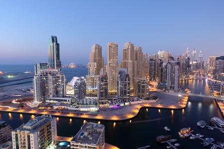 waterfront property: Dubai Marina illuminated at night. United Arab Emirates