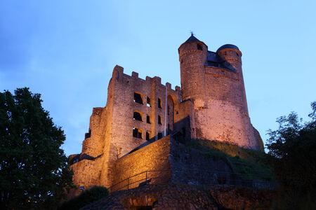 burg: Ancient Castle Greifenstein illuminated at night. Hesse, Germany