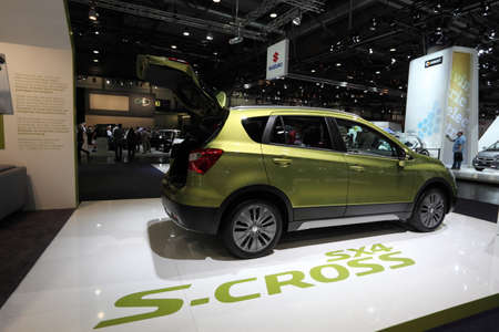 suzuki: LEIPZIG, GERMANY - JUNE 1: New Suzuki SX4 S-Cross at the AMI - Auto Mobile International Trade Fair on June 1st, 2014 in Leipzig, Saxony, Germany