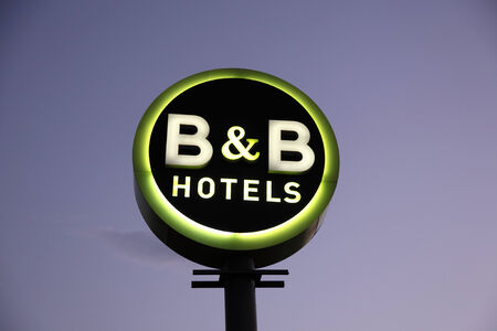 bb: B and B Hotel Sign illuminated at dusk.  B&B is a french hotel chain with over 300 hotels across Europe.