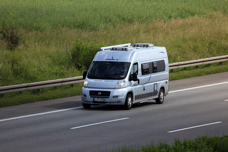 motor home: Small motor home on the highway in Germany