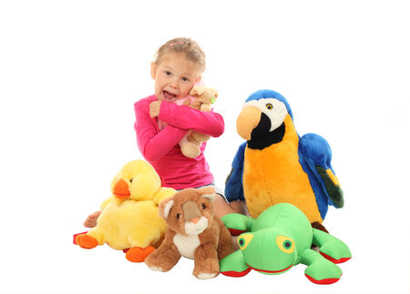 favourite: Little girl with her favourite stuffed animals Stock Photo