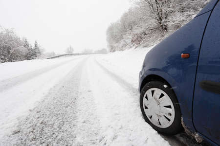 snowcapped: Car on a snow-covered country road in winter