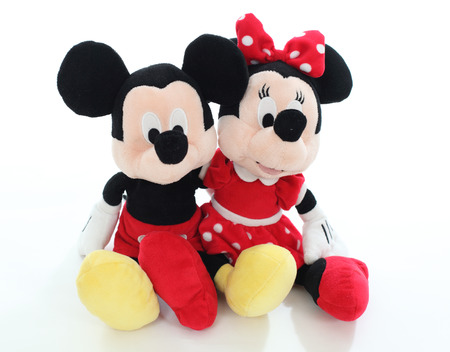 Minnie and Mickey mouse from Disney character. Soft toy isolated over white background