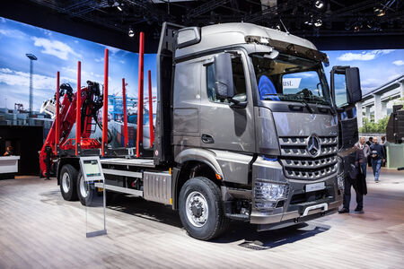 daimler: Mercedes Benz Arocs 2651 LK logging truck at the 65th IAA Commercial Vehicles 2014 in Hannover, Germany Editorial