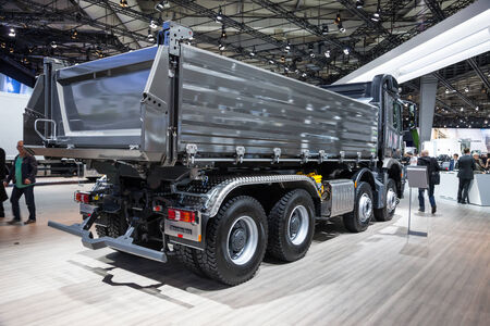 daimler: Mercedes Benz Arocs 4145 dump truck at the 65th IAA Commercial Vehicles 2014 in Hannover, Germany Editorial