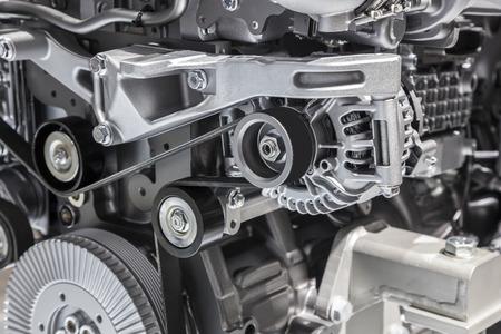 alternator: Alternator with flat drive belt at modern truck engine Stock Photo