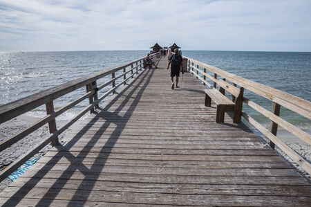 Pier at the Gulf of Mexico coast in Naples, Florida, USA