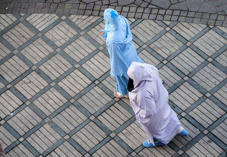 caftan: MARRAKESH, MOROCCO - NOV 20: Berber women wearing traditional islamic clothes . November 20, 2008 in Marrakesh, Morocco Editorial