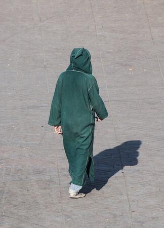 berber: Moroccan man wearing traditional berber coat in Marrakesh, Morocco