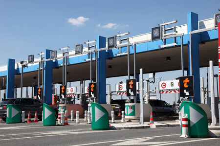 PARIS, FRANCE - JULY 3, 2014: Drivers pay road toll for using the highway A10. July 3, 2014 in Paris, France.