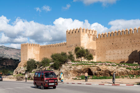 fortify: FEZ, MOROCCO - DEC 2: Street and the ancient fortified wall in Fez. December 2, 2008 in Fez, Morocco, Africa