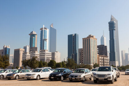city park skyline: Skyline of Kuwait City with a car park in foreground, December 9, 2014 in Kuwait, Middle East