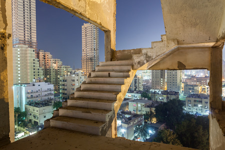 dilapidated: Staircase of an old dilapidated building in Kuwait City Stock Photo