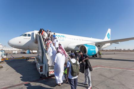 gcc: Jazeera Airways airplane boarding at the Kuwait International Airport. December 12, 2014 in Kuwait City, Middle East