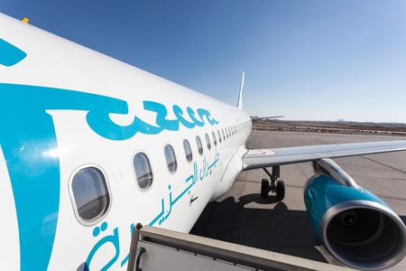 gcc: Jazeera Airways airplane at the Kuwait International Airport. December 12, 2014 in Kuwait City, Middle East
