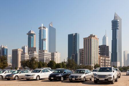 autos: Cars in front of Kuwait City skyscrapers. Middle East, Arabia
