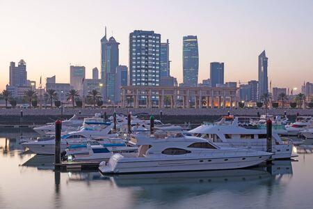 souk: Souk Sharq Marina and Kuwait City at dusk Stock Photo