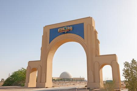 planned: DUBAI, UAE - DEC 13: Dubailand Universal Studios gate in Dubai. Dubailand is a planned entertainment mega-complex ca. 30 km from Dubai. December 13, 2014 in Dubai, UAE Editorial