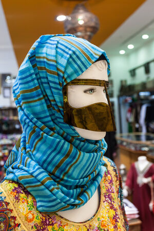 burqa: Traditional arabic women face mask and headscarf Stock Photo