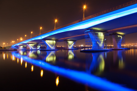 Blue illuminated Al Garhoud Bridge in Dubai, United Arab Emirates