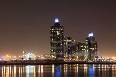 marsa: DUBAI, UAE - DEC 15: The Marsa Plaza Building illuminated at night. December 15, 2014 in Dubai Festival City, United Arab Emirates