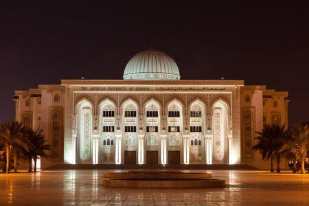 sharjah: SHARJAH, UAE - DEC 17: The American University of Sharjah illuminated at night. December 17, 2014 in Sharjah, United Arab Emirates