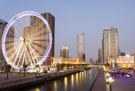 sharjah: Ferris Wheel in Sharjah City at dusk. Sharjah, United Arab Emirates