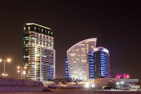 intercontinental: DUBAI, UAE - DEC 16: Intercontinental Hotel at night at Dubai Festival City. December 16, 2014 in Dubai, United Arab Emirates Editorial