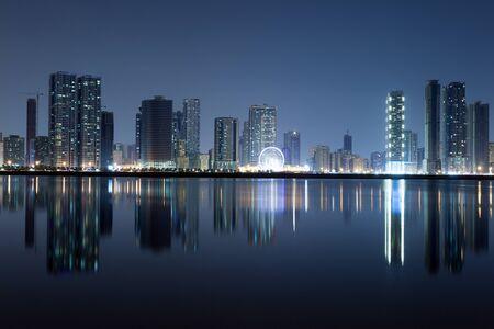 sharjah: Sharjah City skyline at night. Sharjah, United Arab Emirates