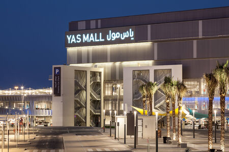 mall of the emirates: ABU DHABI - DEC 19: Yas Mall entrance illuminated at night. December 19, 2014 in Abu Dhabi, United Arab Emirates