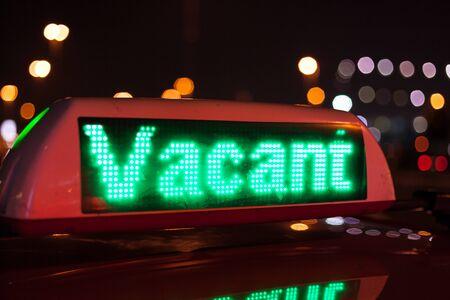 vacant: Vacant taxi sign illuminated at night