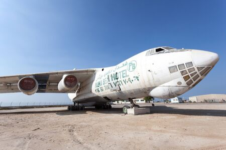 airfield: UMM AL QUWAIN, UAE - DEC 17: Old russian Ilyushin IL 76 cargo plane at the old Umm Al Quwain airfield. December 17, 2014 in Umm Al Quwain, UAE