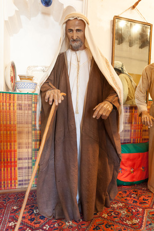 AJMAN, UAE - DEC 17: Bedouin man in traditional dress in the museum of Ajman. December 17, 2014 in Ajaman, United Arab Emirates Editorial