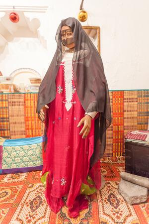 AJMAN, UAE - DEC 17: Bedouin woman in traditional dress in the museum of Ajman. December 17, 2014 in Ajaman, United Arab Emirates