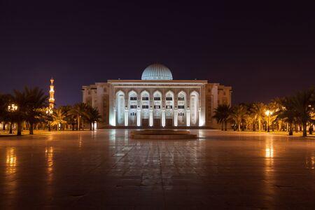 sharjah: SHARJAH, UAE - DEC 17: American University of Sharjah main lecture hall at night. December 17, 2014 in Sharjah, UAE