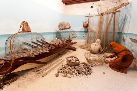 AJMAN, UAE - DEC 17: Scenery with bedouin fishermen in the museum of Ajman. December 17, 2014 in Ajaman, United Arab Emirates Editorial