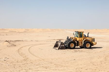 loader: Compact wheel loader in the desert Stock Photo
