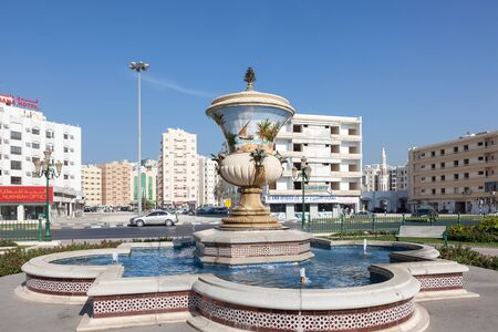 sharjah: SHARJAH, UAE - DEC 20: Fountain at Al Zahra Square in Sharjah City. December 20, 2014 in Sharjah, United Arab Emirates