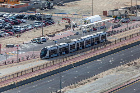 rta: DUBAI, UAE - DEC 16: New tram service in the city of Dubai. December 16, 2014 in Dubai, United Arab Emirates Editorial